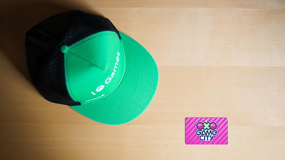 Game City 2014 - Presse-Badge und Xbox One Kapperl